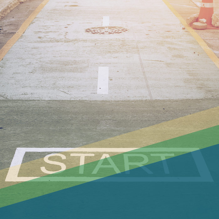 Word START painted on road