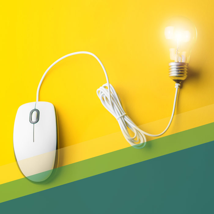 Computer Mouse With Lit Lightbulb On The End Of The Cord